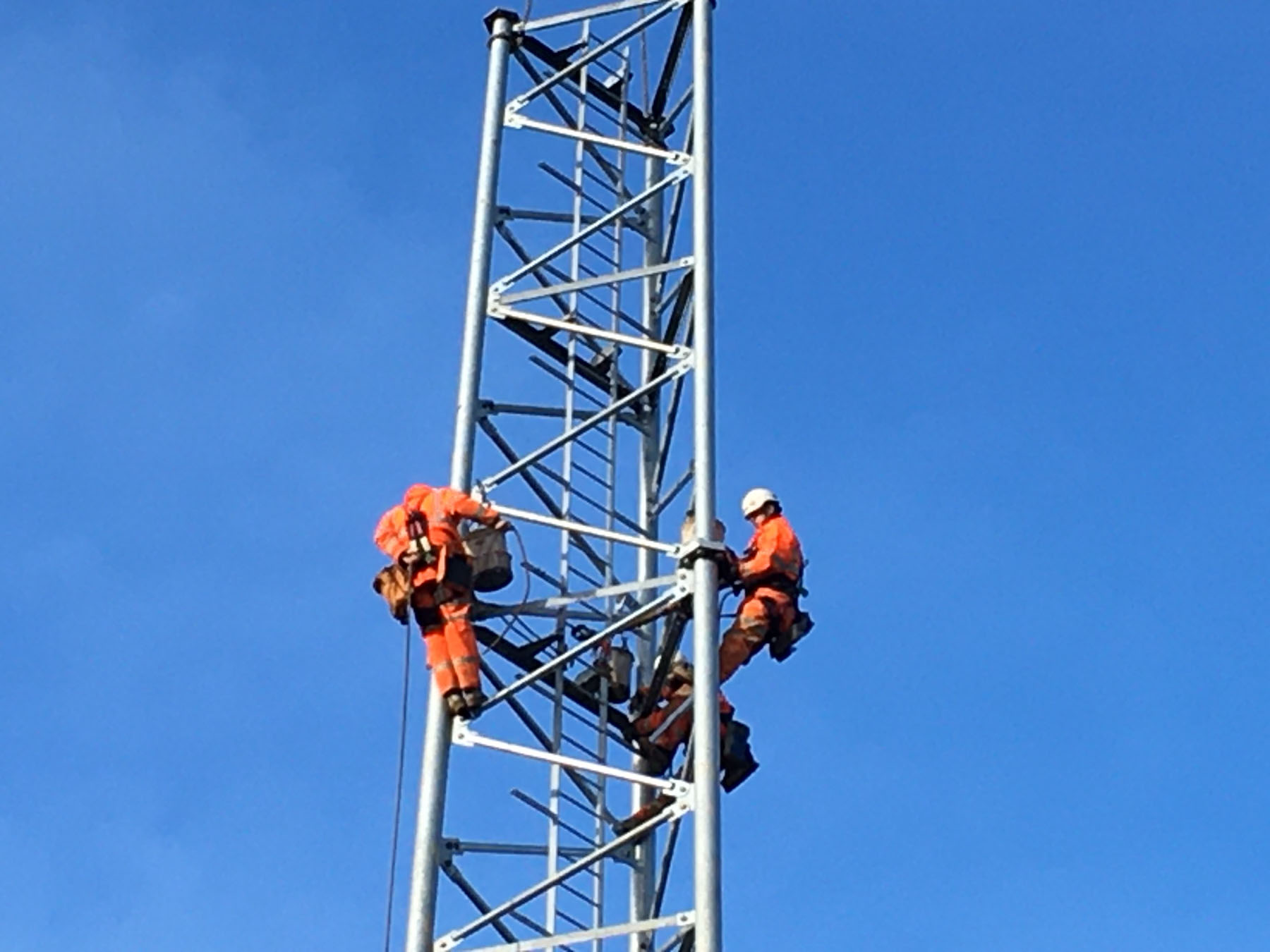 engineers climbing a mobile tower