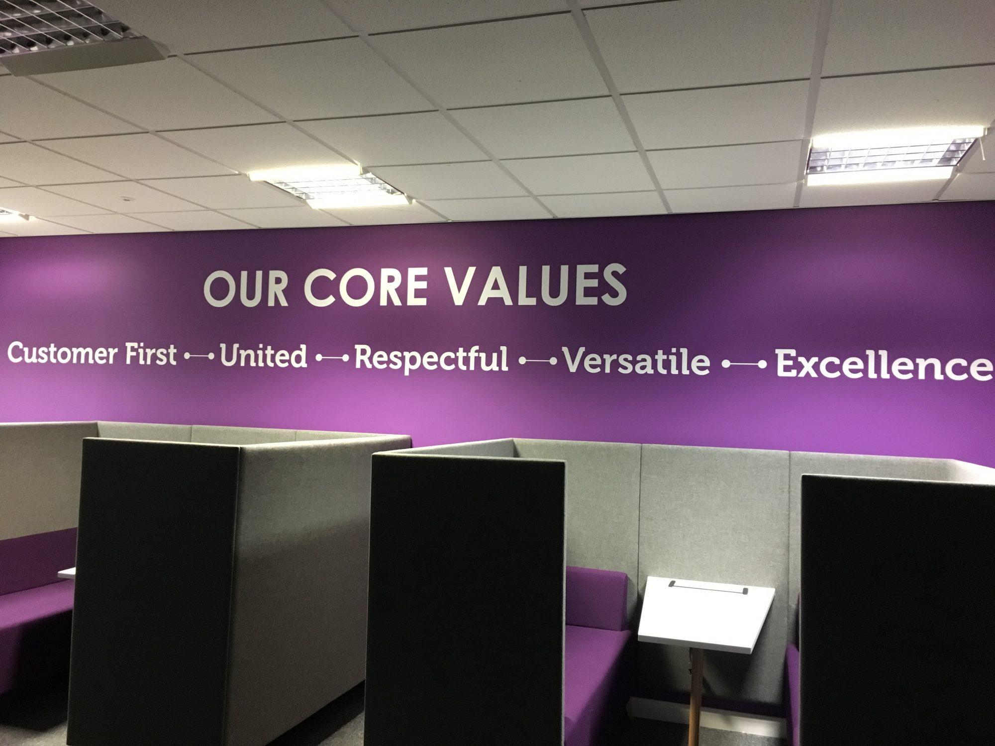 Indigo core values sign on wall