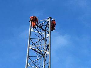 Wireless engineers up a lattice tower