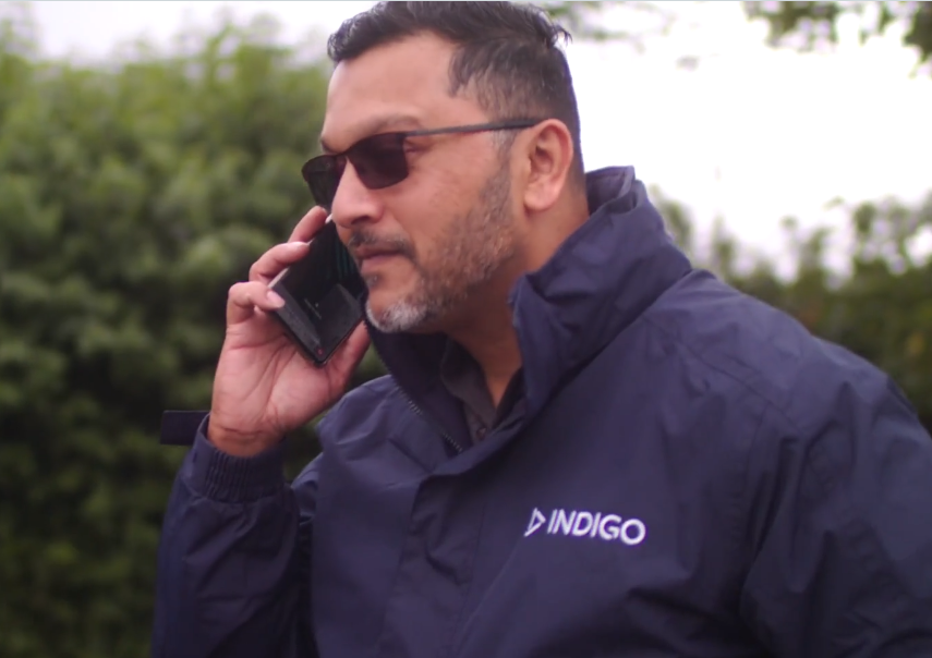 Indigo field engineer on the phone